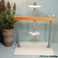 Cheese press with spring